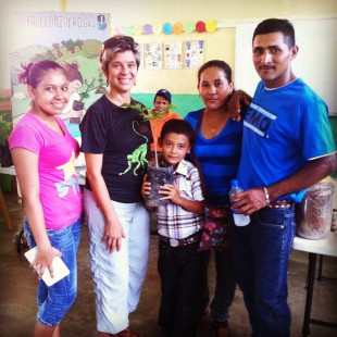 Carmela, Director of Education and Community Outreach, gives a participating family a new tree to plant and watch grow!